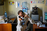 Giuseppe Maniaci, waiting to interview via the phone a politician for his next report...Partinico, Sicily, Italy - June 2006.