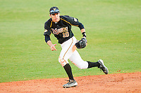Shortstop Eric Garcia #10 of the Missouri Tigers tracks a ground ball against the Charlotte 49ers at Robert and Mariam Hayes Stadium on February 25, 2011 in Charlotte, North Carolina.  Photo by Brian Westerholt / Four Seam Images