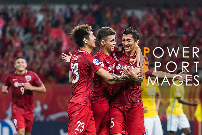 Shanghai FC Midfielder Akhmedov Odil (R) celebrating his score with his teammates Oscar Emboaba Junior (C) and Fu Huan (L) during the AFC Champions League 2017 Round of 16 match between Shanghai SIPG FC (CHN) vs Jiangsu FC (CHN) at the Shanghai Stadium on 24 May 2017 in Shanghai, China. Photo by Marcio Rodrigo Machado / Power Sport Images