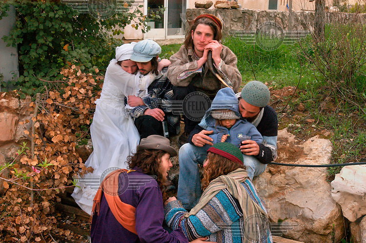 Jewish settlers gather during a Purim holiday party in the Jewish settlement of Elazar.