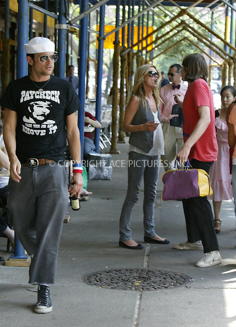 WWW.ACEPIXS.COM ** ** ** ....NEW YORK, JUNE 7, 2005....Johnny Knoxville, Kate Moss and Evan Dando leave their downtown hotel for lunch at Da Silvano. During their lunch, another agency's photographer approaches the table. Evan Dando then stands up and looks as though he has something hidden in a bag or maybe is trying to be menacing with the bag itself. As they leave, it appears as though Kate Moss has an argument with Evan Dando that causes her to cry. During this entire time Johnny Knoxville walks along beside the couple drinking from a glass bottle. Still continuing to drink from his bottle, Johnny Knoxville sits in the back of their cab while Evan Dando rides in the center and Kate Moss talks on her Moto Razr. The trio then return to their downtown hotel.....Please byline: Philip Vaughan -- ACE PICTURES... *** ***  ..Ace Pictures, Inc:  ..Craig Ashby (212) 243-8787..e-mail: picturedesk@acepixs.com..web: http://www.acepixs.com