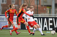 20140208 - OOSTAKKER , BELGIUM : Polish Agnieszka Winczo (r) pictured Belgian Julie Biesmans (m) and Belgian Janice Cayman (11)  during a friendly soccer match between the women teams of Belgium and Poland , Saturday 8 February 2014 in Oostakker. PHOTO DAVID CATRY