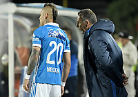 BOGOTA - COLOMBIA -16 -07-2017: Miguel Angel Russo técnico de Millonarios da instrucciones a Juan Guillermo Dominguez durante partido con Independiente Santa Fe por la fecha 2 de la Liga Aguila II 2017 jugado en el estadio Nemesio Camacho El Campin de la ciudad de Bogota. / Miguel Angel Russo coach of Millonarios gives directions to Juan Guillermo Dominguez during match against Independiente Santa Fe for the date 2 of the Liga Aguila II 2017 played at the Nemesio Camacho El Campin Stadium in Bogota city. Photo: VizzorImage / Gabriel Aponte / Staff.