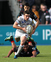 George Ford of Bath Rugby in action with Billy Vunipola of Saracens during the Aviva Premiership match between Saracens and Bath Rugby at Allianz Park, Hendon, England on 26 March 2017. Photo by Stewart  Wright  / PRiME Media Images.