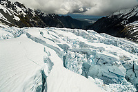 Downstream view into valley across seracs of Main Icefall on Franz Josef Glacier and toward  Tasman Sea on horizon, Westland Tai Poutini National Park, West Coast, UNESCO World Heritage Area, New Zealand, NZ