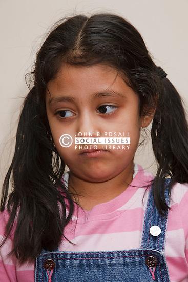 Asian girl looking sad.
