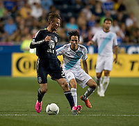 David Beckham (23) of the MLS All-Stars holds the ball away from Yossi Benayoun (30) of Chelsea during the game at PPL Park in Chester, PA.  The MLS All-Stars defeated Chelsea, 3-2.