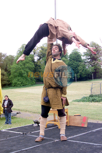 Members of the Belfast Community Circus showing off some of there tricks for the watching crowd at the Medievel festival at Slane Castle.Photo Fran Caffrey/Newsfile.ie..This picture has been sent to you by:.Newsfile Ltd,.3 The View,.Millmount Abbey,.Drogheda,.Co Meath..Ireland..Tel: +353-41-9871240.Fax: +353-41-9871260.GSM: +353-86-2500958.ISDN: +353-41-9871010.IP: 193.120.102.198.www.newsfile.ie..email: pictures@newsfile.ie..This picture has been sent by Fran Caffrey.francaffrey@newsfile.ie