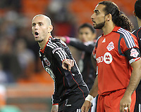 Kurt Morsink #6 of D.C. United points towards Dwayne De Rosario #14 of Toronto FC during an MLS match that was the final appearance of D.C. United's Jaime Moreno at RFK Stadium, in Washington D.C. on October 23, 2010. Toronto won 3-2.