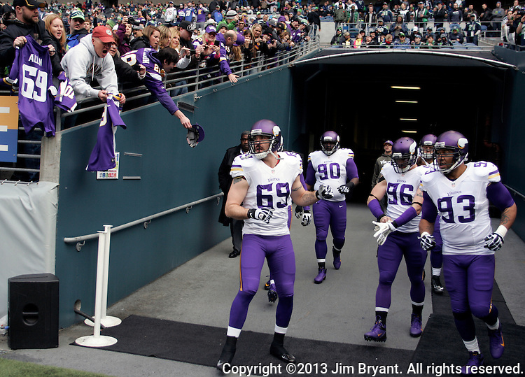 Minnesota Vikings Jared Allen (69), Fred Evans (90), Kevin Williams (93) and Brian Robison (96) get ready to held out on the field for pre-game warm ups  at CenturyLink Field in Seattle, Washington on  November 17, 2013.  The Seahawks beat the Vikings 41-20.  ©2013.  Jim Bryant. All Rights Reserved.