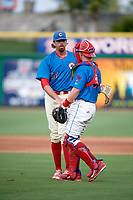 Clearwater Threshers relief pitcher Will Hibbs (56) shakes hands with catcher Henri Lartigue after closing out a game against the Florida Fire Frogs on June 1, 2018 at Spectrum Field in Clearwater, Florida.  Clearwater defeated Florida 2-0 in a game that was started on May 19th but called in the fifth inning due to weather.  (Mike Janes/Four Seam Images)