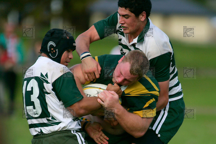 T. Ropotini & J. Metcalf wrap up Mark Price. Counties Manukau Premier Club Rugby, Pukekohe v Manurewa  played at the Colin Lawrie field, on the 17th of April 2006. Manurewa won 20 - 18.