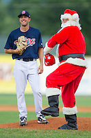 Starting pitcher Pat Dean #46 of the Elizabethton Twins laughs as Santa Claus throws out the first pitch at Joe O'Brien Field August 14, 2010, in Elizabethton, Tennessee.  Photo by Brian Westerholt / Four Seam Images