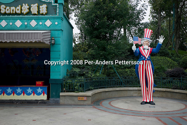 CHENGDU, CHINA OCTOBER 9: An Uncle Sam statue stands at Flora Theme Park on October 9, 2008 in Chengdu, China. The area is know for its fauna and the park has various gardens, theme restaurants and carnival stands. Its also has an Italian street where wedding couples come to take pictures daily. Chinese people love theme parks and new ones are opening constantly. It?s estimated that there?s about 2400 theme parks in the country. (Photo by Per-Anders Pettersson/Getty Images) ..