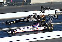 Feb 8, 2015; Pomona, CA, USA; NHRA top fuel driver Antron Brown (near) races alongside Tony Schumacher during the Winternationals at Auto Club Raceway at Pomona. Mandatory Credit: Mark J. Rebilas-USA TODAY Sports