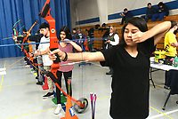NWA Democrat-Gazette/FLIP PUTTHOFF <br /> ON TARGET<br /> Cynthia Aguilar lets an arrow fly Wednesday March 15 2017 during archery competition in Deb Walter's physical education class at Rogers New Tech High School. Students took part in a bull's eye contest on Wednesday. They play archery tic-tac-toe and other games, while shooting arrows from various distances.