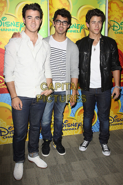 KEVIN JONAS, JOE JONAS & NICK JONAS of THE JONAS BROTHERS.Disney/ABC Television Group Press Junket held At The ABC Television Network Building, Burbank, California, USA..May 15th, 2010.full length white black grey gray shirt top jacket leather stripes stripes glasses jeans denim.CAP/ADM/KB.©Kevan Brooks/AdMedia/Capital Pictures.