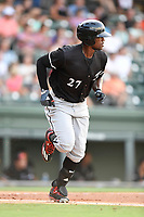 Right fielder Micker Adolfo (27) of the Kannapolis Intimidators bats in a game against the Greenville Drive on Friday, July 14, 2017, at Fluor Field at the West End in Greenville, South Carolina. Greenville won, 2-0. (Tom Priddy/Four Seam Images)