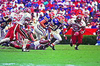 Fred Taylor (21) fumbles the ball, University of Florida Gators defeat the University of South Carolina Gamecocks 48-17 at Ben Hill Griffin Stadium, Florida Field, Gainseville, Florida, November 12, 1994 . (Photo by Brian Cleary/www.bcpix.com)