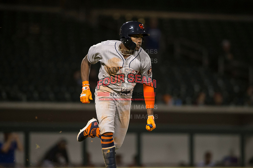 Scottsdale Scorpions center fielder Ronnie Dawson (4), of the Houston Astros organization, hustles down the first base line during an Arizona Fall League game against the Mesa Solar Sox at Sloan Park on October 10, 2018 in Mesa, Arizona. Scottsdale defeated Mesa 10-3. (Zachary Lucy/Four Seam Images)