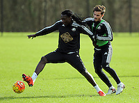 SWANSEA, WALES - JANUARY 28: (L-R) Bafetimbi Gomis against Henry Jones during the Swansea City Training Session on January 28, 2016 in Swansea, Wales.