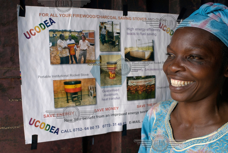 A woman working at the UCODEA (Urban Community Development) office selling High Efficiency Stoves for a project run by Climate Care, whose mission is to reduce greenhouse gas emissions in order to fight global warming.