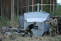 "Players from team SOB remove the flight recorder from a downed ""helicopter"", thus completing one of their missions.<br /> <br /> Airsoft players fight during the mock war ""Ghost Zone"". The game attracted around 140 players from all over Norway, and is the biggest such event in the country. Dressed in full military gear, complete with replica weapons, players from the two teams Goyo and SOB fought each other to control territory, drugs and money. The guns, softguns, weigh and feel like real weapons but only shoot little plastc pellets. All players wear protective glasses for their eyes, but the pellets are otherwise not considered dangerous."