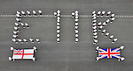 """QUEEN'S JUBILEE CELEBRATIONS.Sailors from HMS Raleigh have paid a special tribute to Her Majesty The Queen on the occasion of her Diamond Jubilee by forming the letters EIIR on the establishment's parade ground..Picture shows: The display showing members of Corperate Sqn and the two directing Physical Training Instructors along with the Union Flag and the White Ensign_02/06/2012.Mandatory Credit Photo: ©J Rouse/NEWSPIX INTERNATIONAL..**ALL FEES PAYABLE TO: """"NEWSPIX INTERNATIONAL""""**..IMMEDIATE CONFIRMATION OF USAGE REQUIRED:.Newspix International, 31 Chinnery Hill, Bishop's Stortford, ENGLAND CM23 3PS.Tel:+441279 324672  ; Fax: +441279656877.Mobile:  07775681153.e-mail: info@newspixinternational.co.uk"""