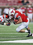 Southern Methodist Mustangs running back Zach Line (48) and Houston Cougars defensive back Kent Brooks (24) in action during the game between the University of Houston Cougars and the Southern Methodist Mustangs at the Gerald J. Ford Stadium in Dallas, Texas. SMU defeats Houston 72 to 42...