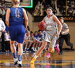 BROOKINGS, SD - MARCH 23:  Kerri Young #10 from South Dakota State brings the ball up against McKenzie Fujan #11 from Creighton in the first half of their WNIT game Sunday afternoon at Frost Arena in Brookings. (Photo by Dave Eggen/Inertia)