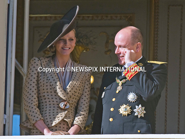"""Charlene Wittstock and Prince Albert II of Monaco; .MONACO NATIONAL DAY 2010 (Fête Nationale Monégasque 2010).The Royal Family greet the crowds and watch the Army Parade from the balcony of the Prince's palace as part of Monaco's National Day celebrations. Monaco_19/11/2010..Mandatory Photo Credit: ©Dias/Newspix International..**ALL FEES PAYABLE TO: """"NEWSPIX INTERNATIONAL""""**..PHOTO CREDIT MANDATORY!!: NEWSPIX INTERNATIONAL(Failure to credit will incur a surcharge of 100% of reproduction fees)..IMMEDIATE CONFIRMATION OF USAGE REQUIRED:.Newspix International, 31 Chinnery Hill, Bishop's Stortford, ENGLAND CM23 3PS.Tel:+441279 324672  ; Fax: +441279656877.Mobile:  0777568 1153.e-mail: info@newspixinternational.co.uk"""