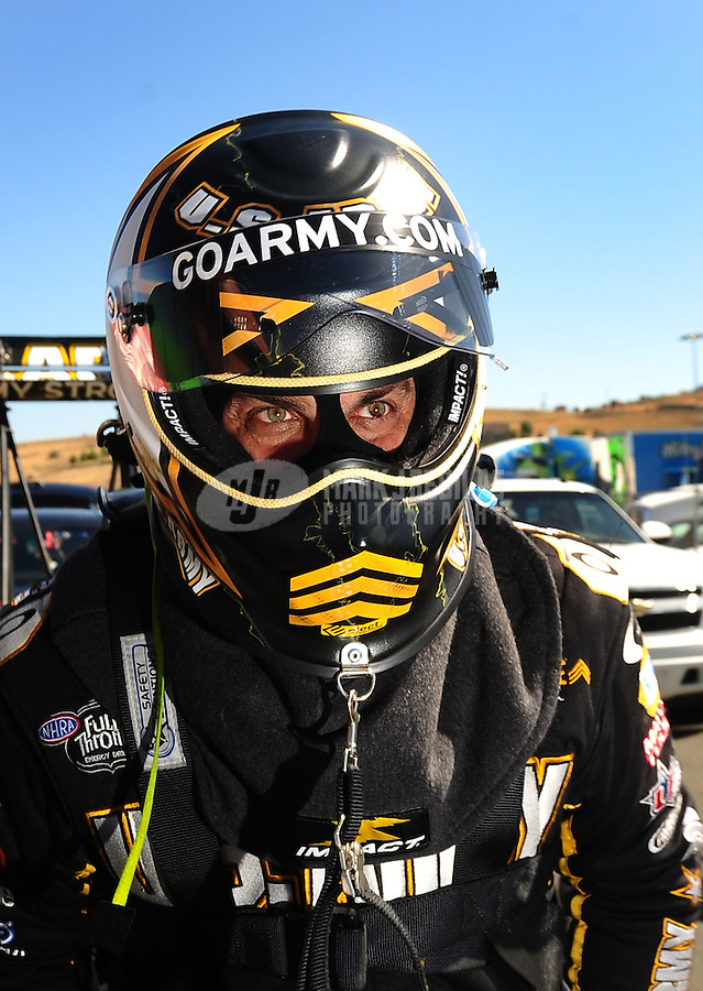 Jul. 17, 2010; Sonoma, CA, USA; NHRA top fuel dragster driver Tony Schumacher climbs into his car during qualifying for the Fram Autolite Nationals at Infineon Raceway. Mandatory Credit: Mark J. Rebilas-