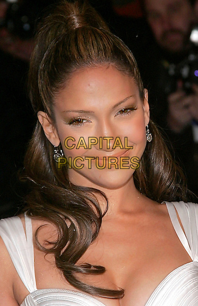 JENNIFER LOPEZ.Versace Store Re-Opening Party at Versace 5th Avenue StoreNew York, NY, USA..February 7th, 2006.Photo: Jackson Lee/Admedia/Capital Pictures.Ref: JL/ADM.headshot portrait smiling.www.capitalpictures.com.sales@capitalpictures.com.© Capital Pictures.