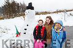 April, Casey and Kely Mahony with their snowman in Kilflynn on Friday.