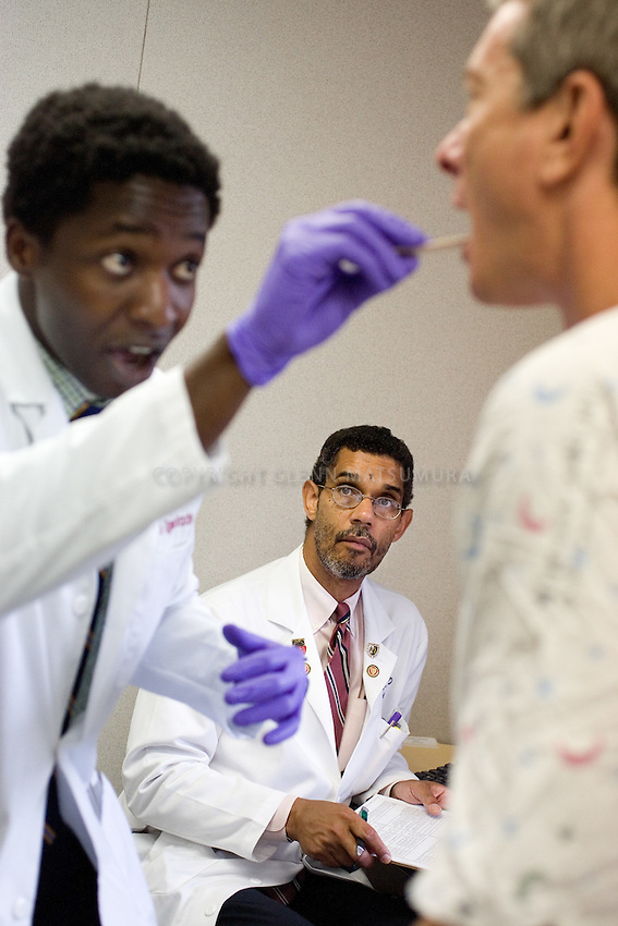 Dr. Charles Braddock overseeing standarized patient exams for Stanford Med School. First-year student Kunle Ogunrinade.