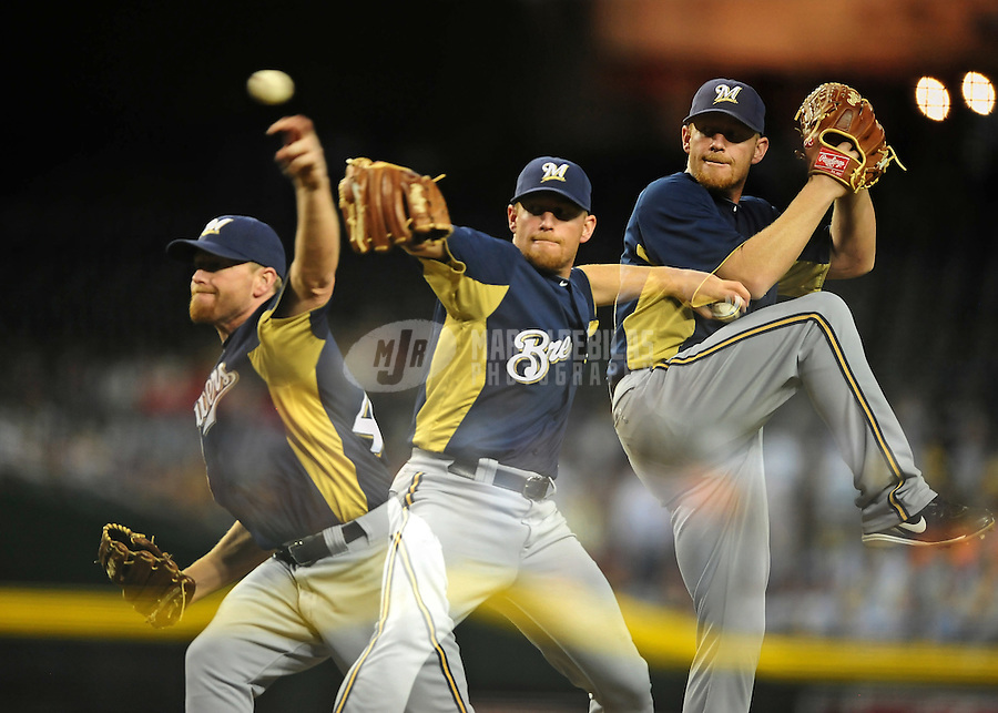 Apr. 3, 2012; Phoenix, AZ, USA; (Editors note: Multiple exposure image) Milwaukee Brewers pitcher Randy Wolf throws in the fourth inning against the Arizona Diamondbacks during a spring training game at Chase Field.  Mandatory Credit: Mark J. Rebilas-