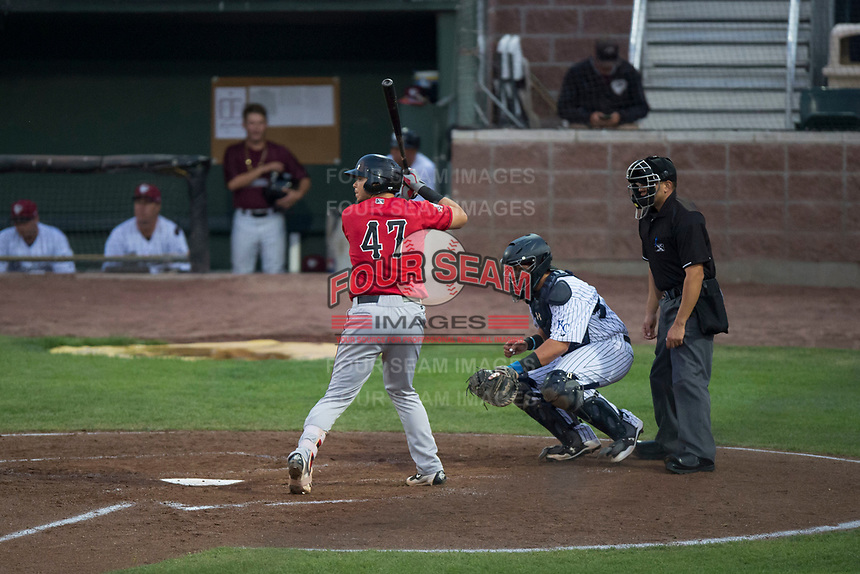 Billings Mustangs catcher Pabel Manzanero (47) at bat in front of catcher Chase Vallot (44) and home plate umpire Ethan McCranie during a Pioneer League game against the Idaho Falls Chukars at Melaleuca Field on August 22, 2018 in Idaho Falls, Idaho. The Idaho Falls Chukars defeated the Billings Mustangs by a score of 5-3. (Zachary Lucy/Four Seam Images)