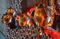 Detail of gilded glass balls, candles and the aluminium valance made with Arsculpt and Technical Industrie, surrounding the reliquaries in the Bell tower room themed 'Le Merveilleux' or The Supernatural, first floor, in Le Tresor de la Cathedral d'Angouleme, in Angouleme Cathedral, or the Cathedrale Saint-Pierre d'Angouleme, Angouleme, Charente, France. The 12th century Romanesque cathedral was largely reworked by Paul Abadie in 1852-75. In 2008, Jean-Michel Othoniel was commissioned by DRAC Aquitaine - Limousin - Poitou-Charentes to display the Treasure of the Cathedral in some of its rooms, which opened to the public on 30th September 2016. Picture by Manuel Cohen. L'autorisation de reproduire cette oeuvre doit etre demandee aupres de l'ADAGP/Permission to reproduce this work of art must be obtained from DACS.