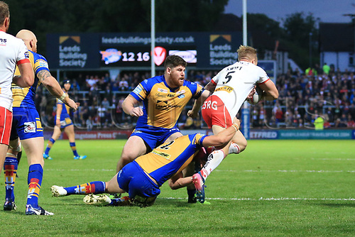 June 29th 2017, Headingley Carnegie, Leeds, England; Betfred Super League; Leeds Rhinos versus St Helens; Tom Briscoe of Leeds Rhinos tackles Adam Swift of St Helens