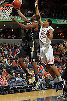 Wake Forest guard Miles Overton (20) shoots in front of Virginia guard Malcolm Brogdon (15) during the first half of an NCAA basketball game Wednesday Jan. 08, 2014 in Charlottesville, VA. (Photo/The Daily Progress/Andrew Shurtleff)