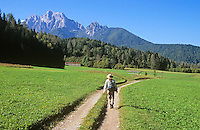 Hiker on rural roadway near village of Kranjska Gora in the Julian Alps, Slovenia, AGPix_0552.