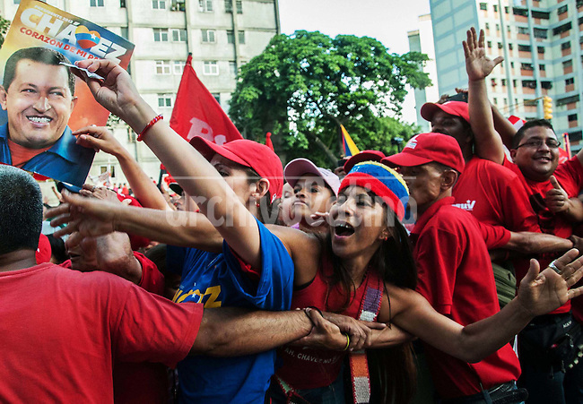 Venezuela: Caracas,26/07/12 .Venezuela's President Hugo Chavez greets his supporters, during a rally in the neighborhood of El Valle, in Caracas, in his election campaign for reelection to the next presidential elections in Venezuela on October 7..Carlos Hernandez/Archivolatino