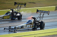 Sept. 22, 2012; Ennis, TX, USA: NHRA top fuel dragster driver Tony Schumacher (near lane) races alongside Morgan Lucas during qualifying for the Fall Nationals at the Texas Motorplex. Mandatory Credit: Mark J. Rebilas-