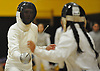 Alexandra Gillis of Commack, left, duels against Alexandra Velasquez of Brentwood in epee during a girls fencing match at Commack High School on Friday, Dec. 2, 2016. Gillis won the bout 5-2.