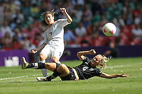 Karen CARNEY of Great Britain is tackled by Katie HOYLE of New Zealand - Great Britain Women vs New Zealand Women - Womens Olympic Football Tournament London 2012 Group E at the Millenium Stadium, Cardiff, Wales - 25/07/12 - MANDATORY CREDIT: Gavin Ellis/SHEKICKS/TGSPHOTO - Self billing applies where appropriate - 0845 094 6026 - contact@tgsphoto.co.uk - NO UNPAID USE.