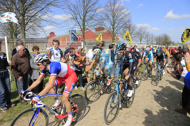 The peloton including Arnaud Demare (FRA) FDJ and Sir Bradley Wiggins (GBR) Team Sky tackle Sector 10 Mons-en-Pevele during the 113th edition of the Paris-Roubaix 2015 cycle race held over the cobbled roads of Northern France. 12th April 2015.<br /> Photo: Eoin Clarke www.newsfile.ie