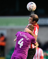 Lincoln City's Matt Rhead vies for possession with Carlisle United's Gary Liddle<br /> <br /> Photographer Chris Vaughan/CameraSport<br /> <br /> The Emirates FA Cup Second Round - Lincoln City v Carlisle United - Saturday 1st December 2018 - Sincil Bank - Lincoln<br />  <br /> World Copyright © 2018 CameraSport. All rights reserved. 43 Linden Ave. Countesthorpe. Leicester. England. LE8 5PG - Tel: +44 (0) 116 277 4147 - admin@camerasport.com - www.camerasport.com