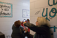 NWA Democrat-Gazette/CHARLIE KAIJO Visitors take pictures of art in the bathroom on Thursday, November 9, 2017 at Eastside Elementary School in Rogers. The school hosted its Leadership Day, a chance for students to showcase how they live by The 7 Habits of Highly Successful People by Stephen R. Covey through an initiative called Leader in Me.