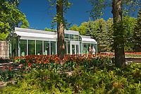 Tulips and Leo Mol Gallery in Leo Mol Sculpture Garden in Assiniboine Park<br /> Winnipeg<br /> Manitoba<br /> Canada