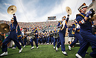 Aug. 30, 3014; The Notre Dame Marching Band runs onto the field before the season opening football game against Rice..Photo by Peter Ringenberg/University of Notre Dame
